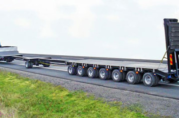 Низкорамные платформы-трейлеры для крупногабаритных перевозок от компании «НегабаритТранс»